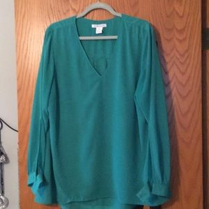 Green blouse with covered buttons and sheer lining